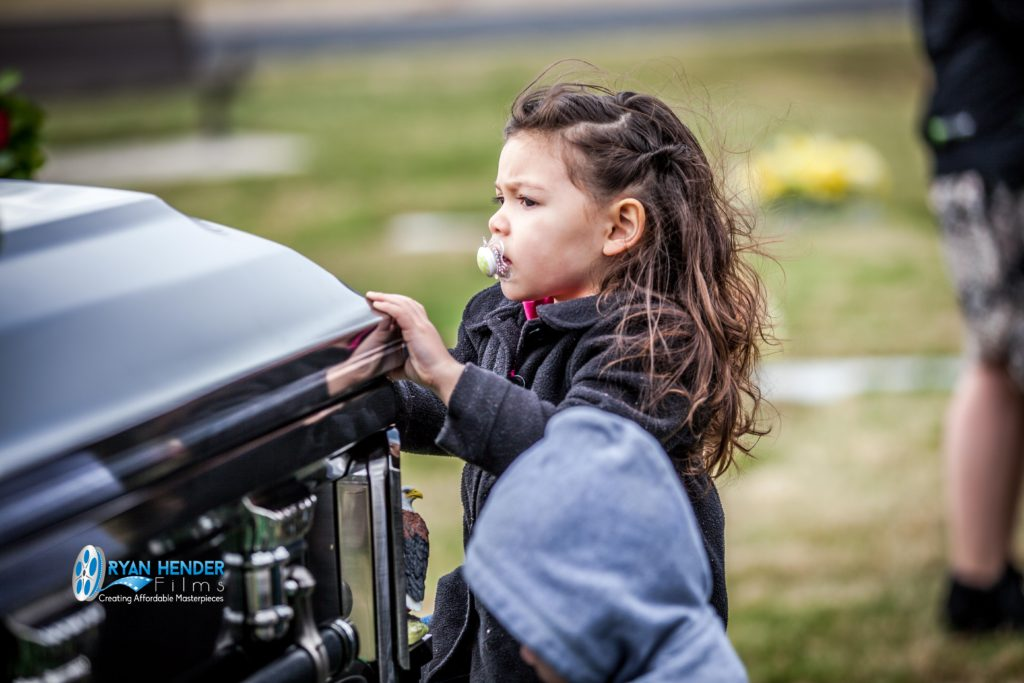 niece standing at casket funeral photography utah Ryan hender films