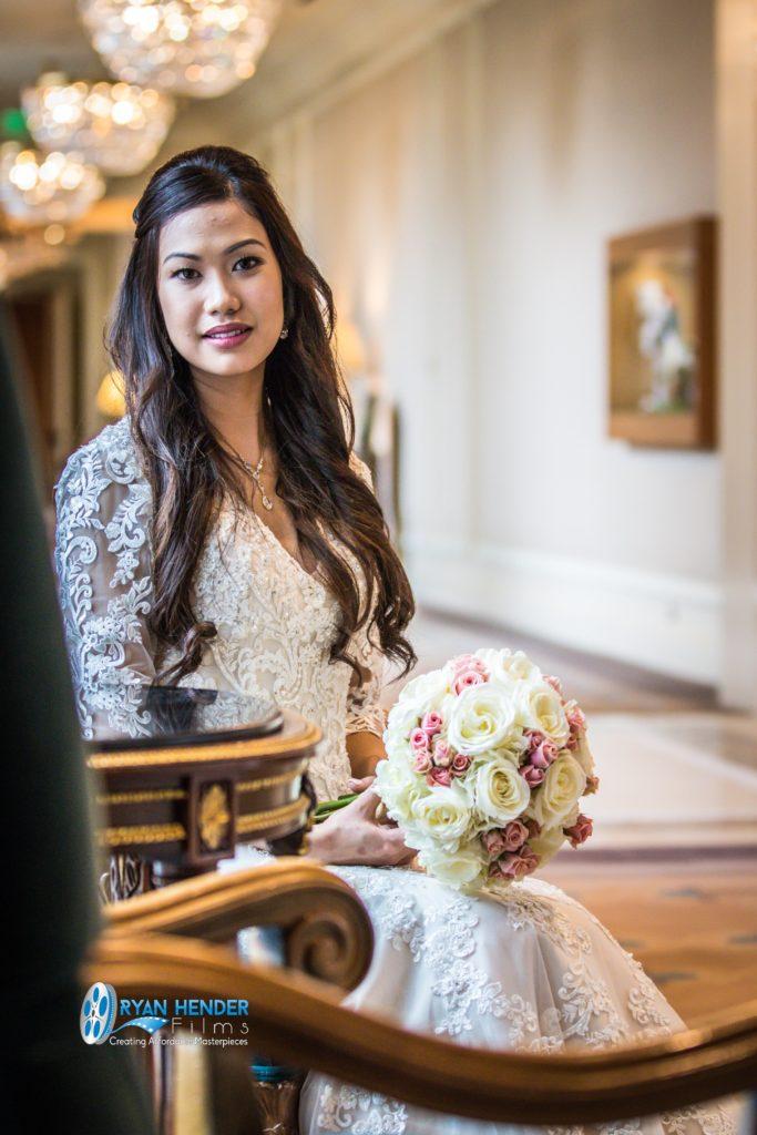 bride sitting in chair grand america