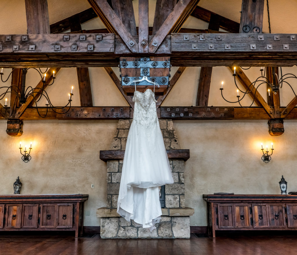 WEEDDING DRESS HANGING FROM BEAM IN CASTLE