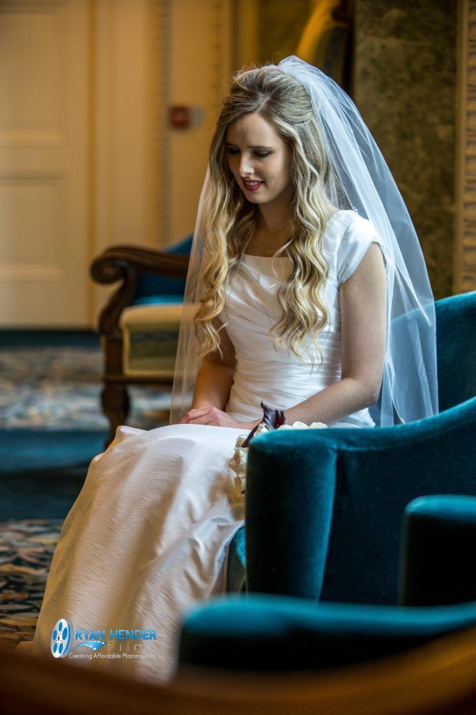 beautiful bride sitting in chair wedding photography