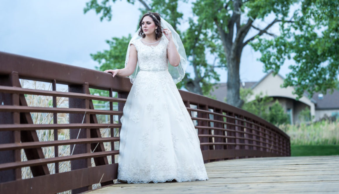 bride standing on bridge draper utah wedding photography