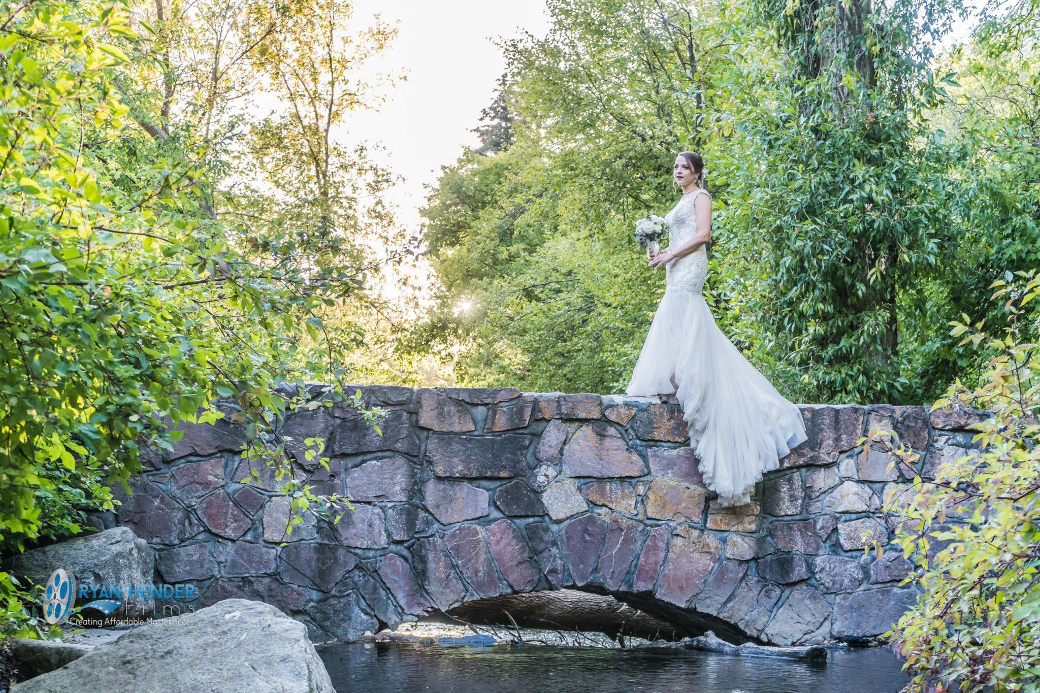 bride waiting on bridge for groom