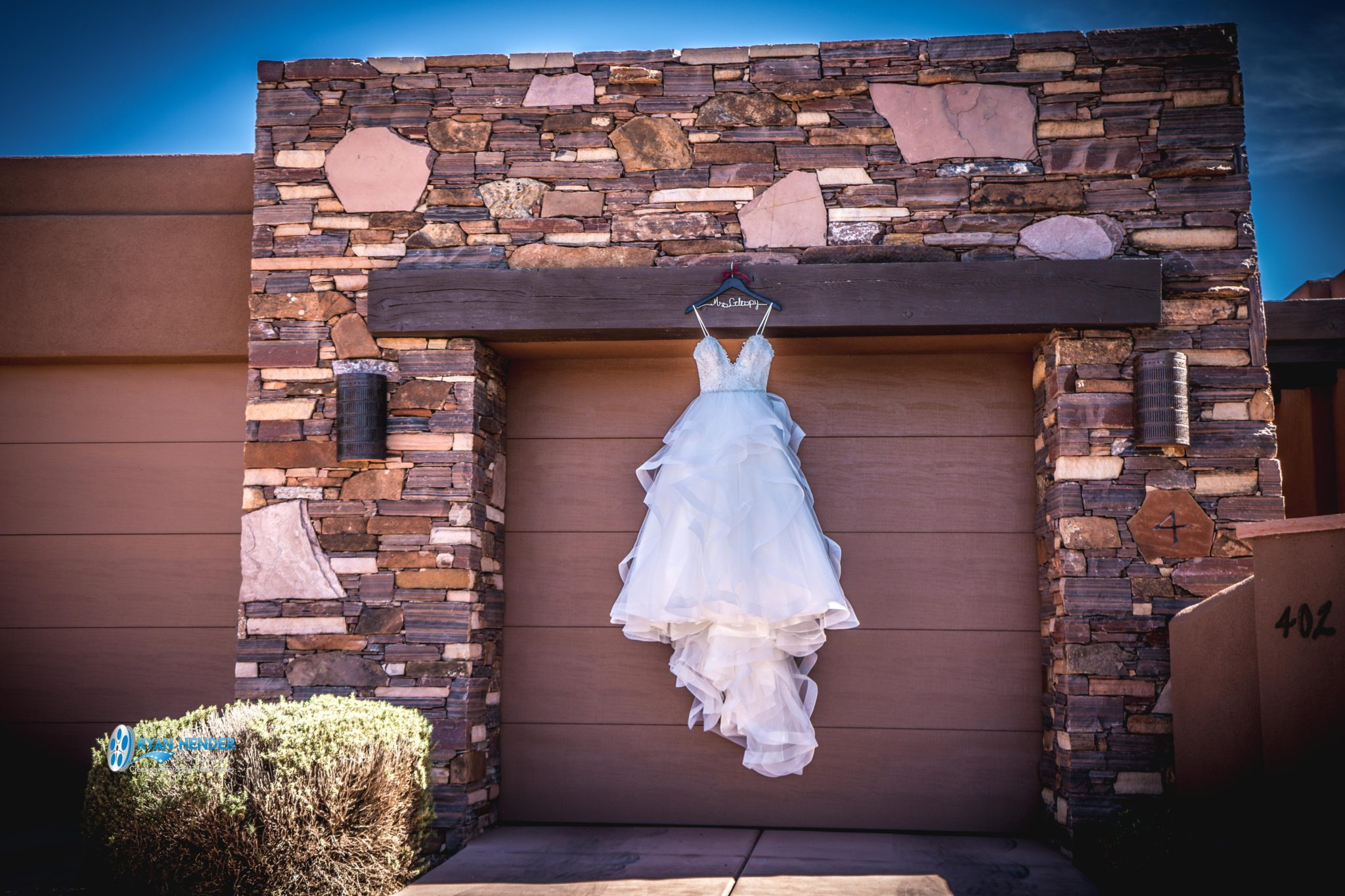 bride's dress hanging on garage