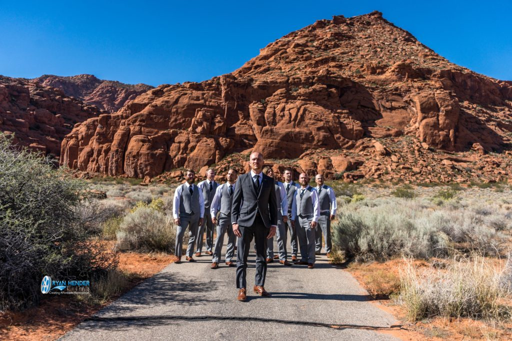Flying V formation groomsmen pose