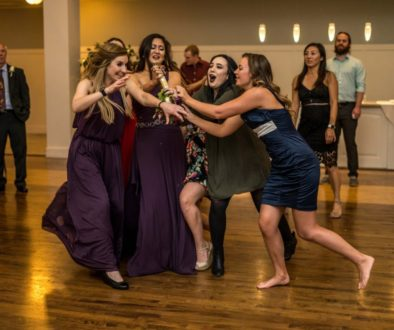 bridesmaids catching bouquet