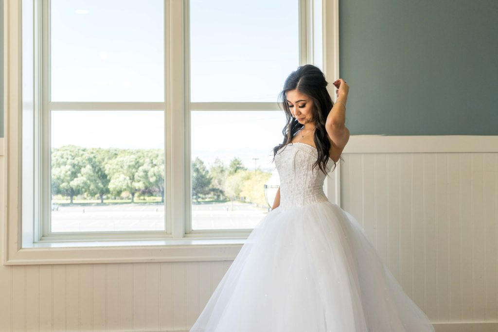 bride in front of window