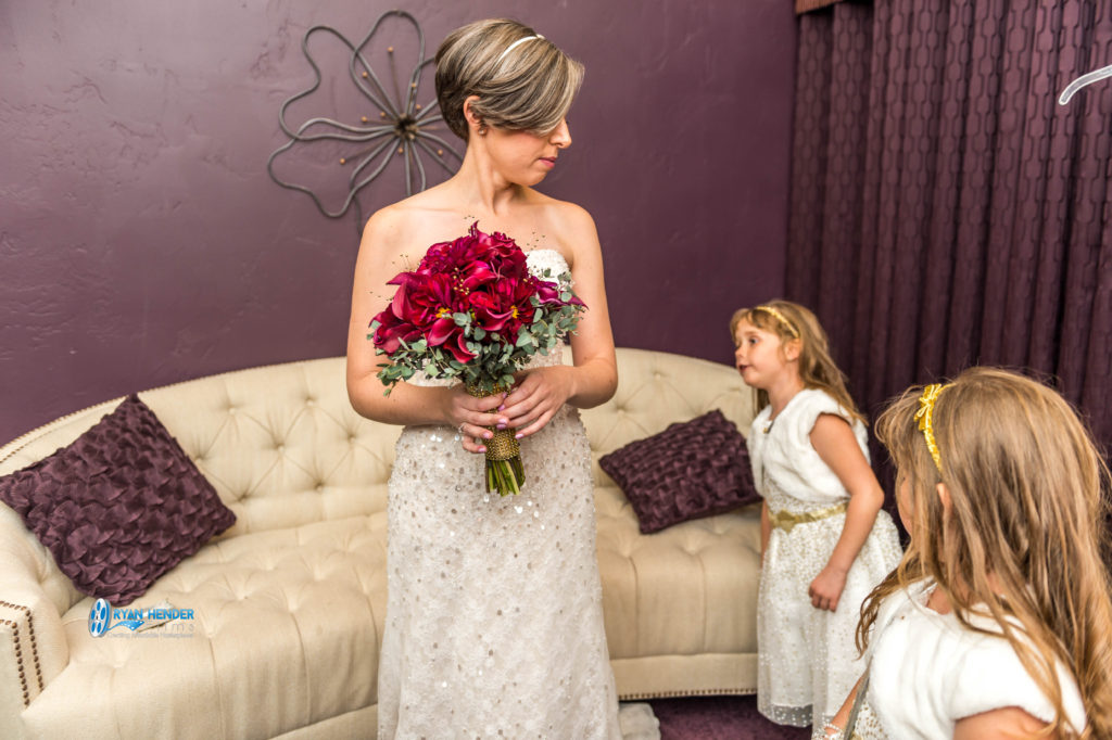 flower girl looking at bride